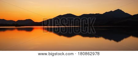 Beautiful colorful sunset at lake Liptovska Mara and mountains at backround. Hill Choc