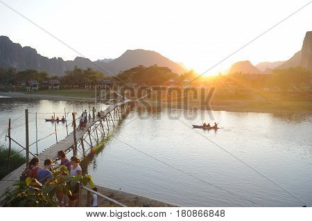Vang Vien Laos - 15 January 2012: People traveling in a canoe in the river near the village of Vang Vien