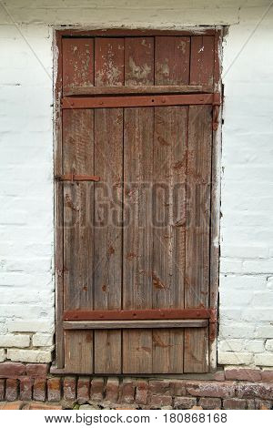 old barn wooden door with cracked paint