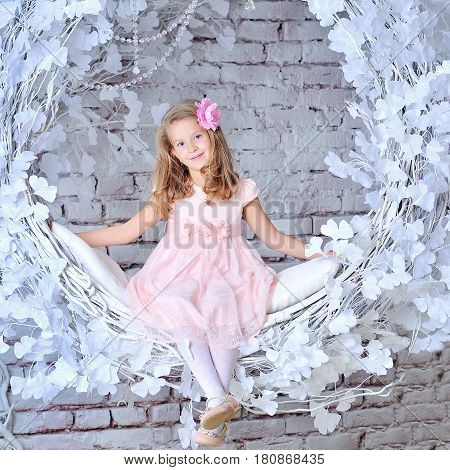 Studio Portrait of Smiling Girl in pink dress