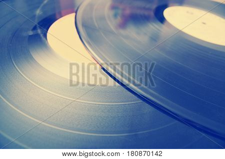 Segment of vinyl record with label showing the texture of the grooves retro look sun over vinyl lifestyle positive photography