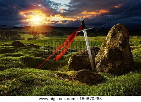 Sword on the meadow with stones under the dramatic sky. Storm heaven and sun lights. Photos montage with 3D render illustration.