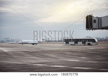 Bus driving from commercial jet after flight. They locating at airport