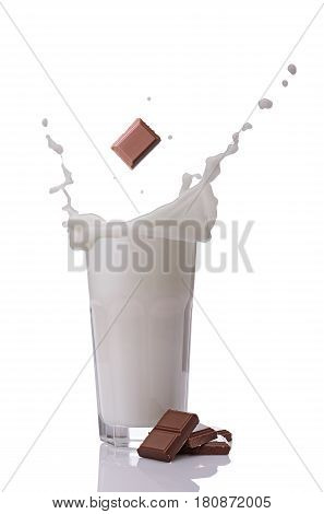 ..splash In Glass Of Milk With Falling Chocolate