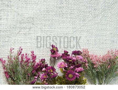 Arrangement Of Artificial Flowers Located On Jute Sackcloth Background Useful As Easter Background A