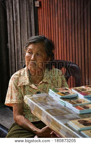 PENANG MALAYSIA- 29 DECEMBER 2016: An old lady selling souvenir at Chew Jetty Penang Malaysia. Chew Jetty is one of the old Chinese waterfront settlement in Penang.