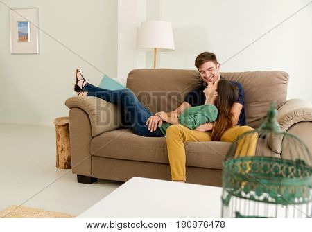 Young couple sitting on the sofa and dating