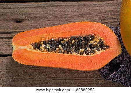 Papaya On Wooden Background. Sliced Of Papaya.
