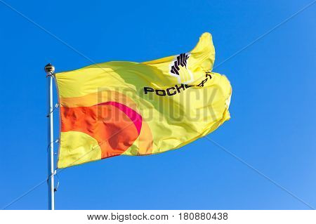 SAMARA RUSSIA - FEBRUARY 20 2016: The flag of oil company Rosneft against blue sky. Rosneft is one of the largest russian oil companies