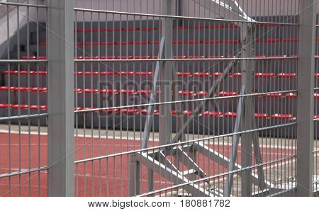 Enclosed basketball court with metal fence