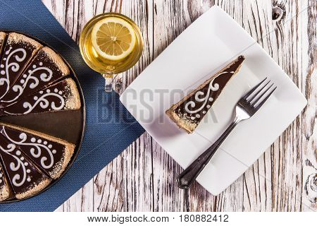 Cup Of Coffee And Delicious Cake On Wooden Table