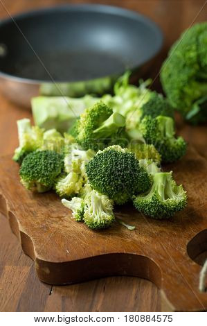 Healthy Green Organic Raw Broccoli Florets Ready for Cooking. Broccoli.Raw fresh broccoli on wooden table.