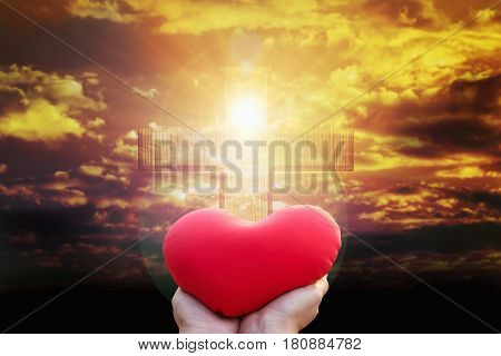 Hand Raise Red Heart Shape On Light From Golden Sky Or Heaven Shine Trough Crucifix Form