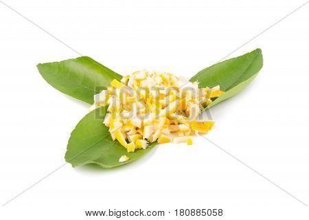 peel chopped lemon zest isolated on a white background.