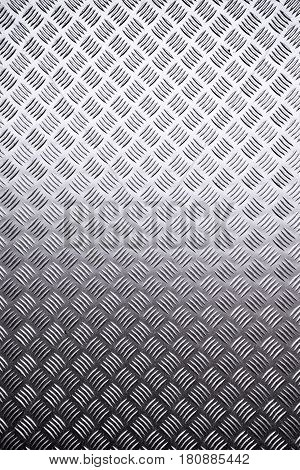 Metal surface background with repeating diamond pattern industrial metallic plate texture