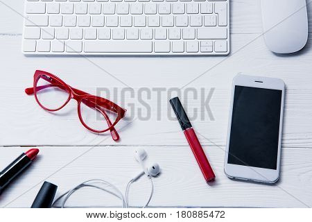 Top View Of Smartphone, Keyboard And Beauty Supplies On Table