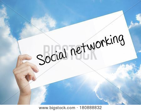 Social Networking Sign On White Paper. Man Hand Holding Paper With Text. Isolated On Sky Background
