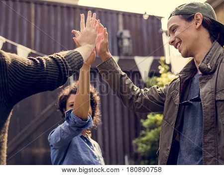 Group of people high five for support and achievement