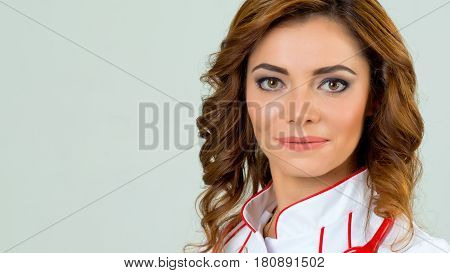 Close up of portrait of beautiful female doctor on white background with the copy space for something healthcare product.