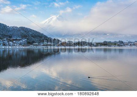 Mountain Fuji and Kawaguchiko lake with morning mist in winter season