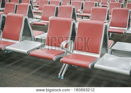 Row Of Red Seats At Airport Terminal