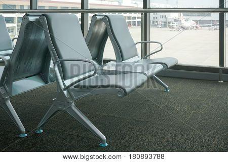 Row Of Gray Seats At Airport Terminal