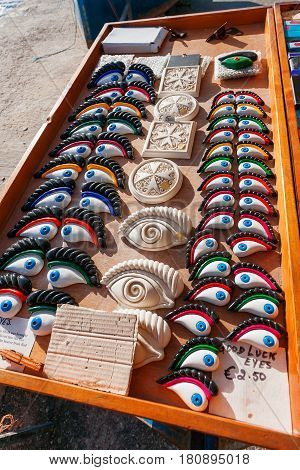 Good luck eyes and Maltese cross traditional souvenirs for tourists on Malta.