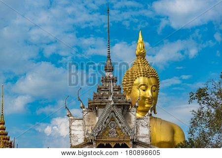 Giant Golden Sitting Buddha Statue And Buddhist Temple