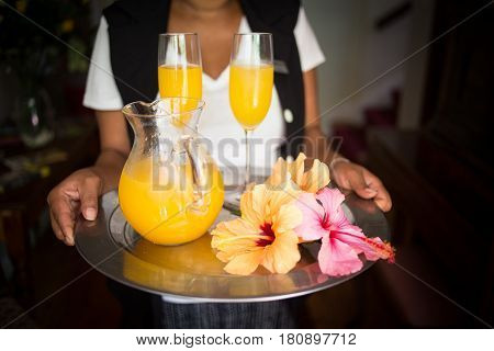 Close Up Image Of A Jug Of Juice And Two Champagne Glasses At An Upmarket Guesthouse