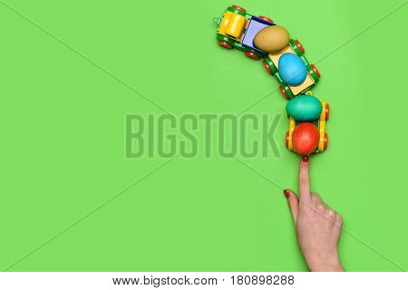 Female Hand With Colorful Easter Eggs In Lorry Car Toy