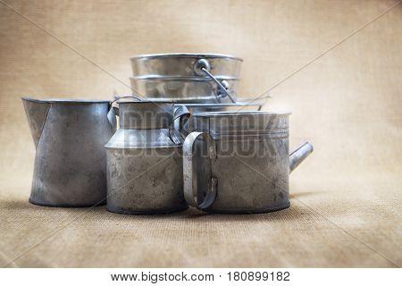 Metal zinc bucket and bottle with sack background