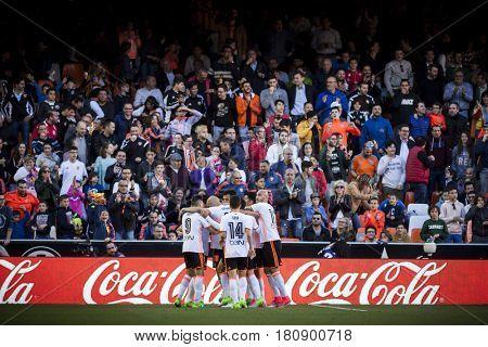 VALENCIA, SPAIN - APRIL 2: Valencia players celebrate a goal during La Liga match between Valencia CF and Deportivo at Mestalla Stadium on April 2, 2017 in Valencia, Spain