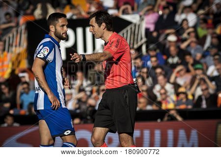 VALENCIA, SPAIN - APRIL 2: Referee talks with Andone during La Liga match between Valencia CF and Deportivo at Mestalla Stadium on April 2, 2017 in Valencia, Spain
