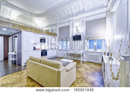 Classic interior design duplex apartment with white wall and ceiling moldings.Russia, Moscow region - interior design living room .