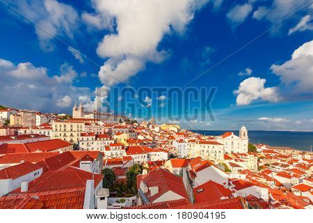 View of Alfama, the oldest district of the Old Town, with Monastery of Sao Vicente de Fora, Church of Saint Stephen and National Pantheon on the sunny afternoon, Lisbon, Portugal