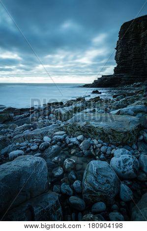 Rocks on the coast next to the cliff face at Nash Point Glamorgan coast Wales