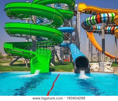 Colorful aquapark sliders with pool. Sport and active life
