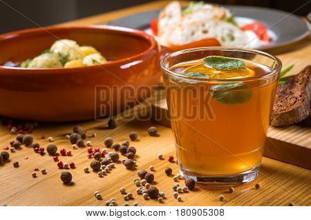 Traditional Ukrainian drink uzvar compote lemonade on a wooden table decorated with lemon