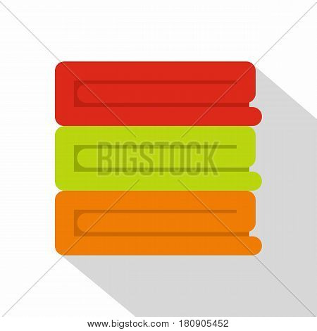 Stack of colored towels icon. Flat illustration of stack of colored towels vector icon for web