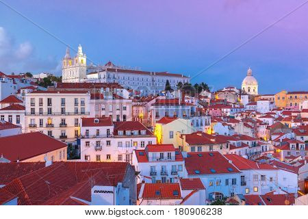 View of Alfama, the oldest district of the Old Town, with Church of Saint Stephen and National Pantheon during evening blue hour, Lisbon, Portugal