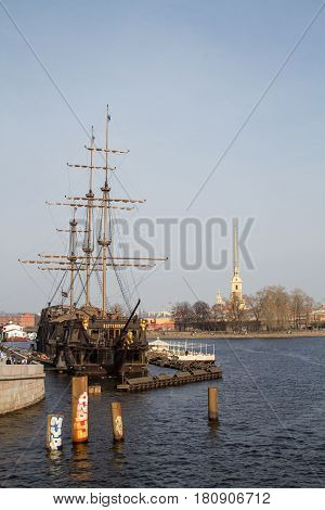 St. Petersburg-09.04.2017: wooden sailer converted to a restaurant, in the background Peter and Paul Fortress