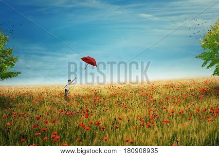 Young boy stand on a country meadow with million of red poppies trying to catch his red umbrella that fly to the sky. The pursuit of happiness and success concept. Life joy fun and happiness.