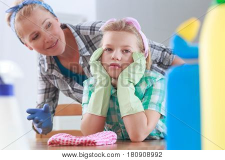 Girl With Rubber Gloves Sitting At A Table