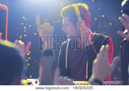 Disc Jockey And Crowd