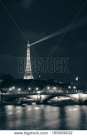 PARIS, FRANCE - MAY 13: Eiffel Tower and River Seine at night on May 13, 2015 in Paris. With the population of 2M, Paris is the capital and most-populous city of France