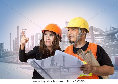 Construction engineers or architects inspect building site of factory