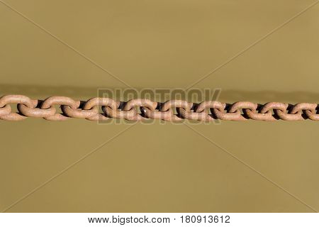 Close-up of a old rusty chain. Streched Chain above the water.