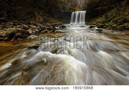 Rocks in front of the Sgwd yr Eira waterfall Brecon Beacons Wales