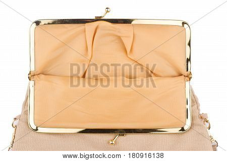 detail of open vintage cream colored female handbag with golden metal enclosure isolated on white