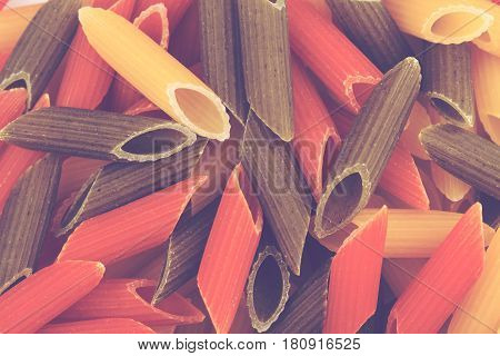 top view food background uncooked penne durum wheat pasta with spinach and red tomato